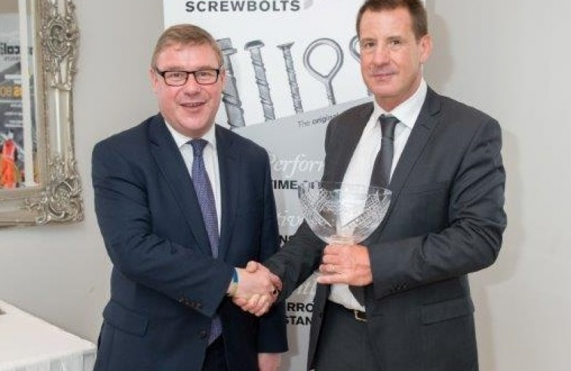 Mark Francois pictured with Director of Excalibur Screwbolts John Stevens and their recent Queen's Award for Innovation, which was presented to the firm who are based in Hockley.