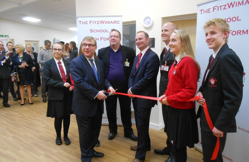 Mark Francois pictured cutting a ribbon at the opening ceremony of the new FitzWimarc School sixth form.