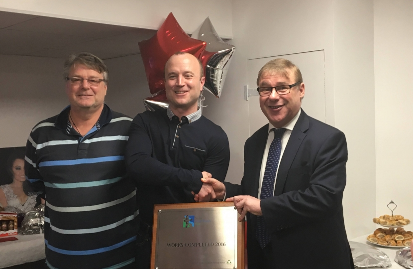 Mark Francois pictured alongside Gary Bacon of the Veolia North Thames Trust and Paul Reynolds, the chairman of the Ultima Trampoline club, handing over a plaque to commemorate the completion of their new club facilities in Wickford