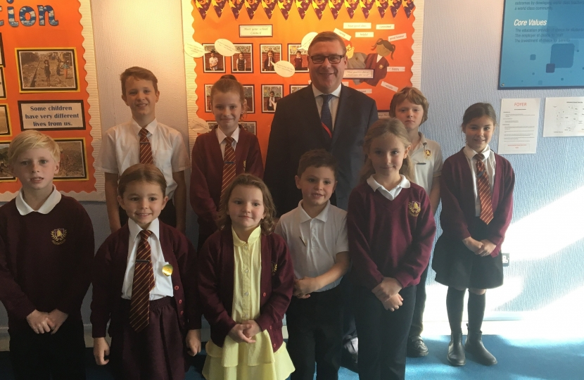 Mark Francois MP pictured alongside members of the Ashingdon Primary School Council who quizzed him on his role as an MP during his recent visit to the school.