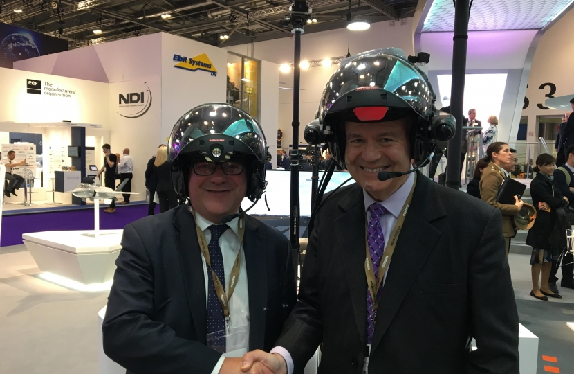 Rayleigh and Wickford MP Mark Francois pictured trying out the new Striker II pilot's helmet alongside HCDC Chairman Dr Julian Lewis MP.