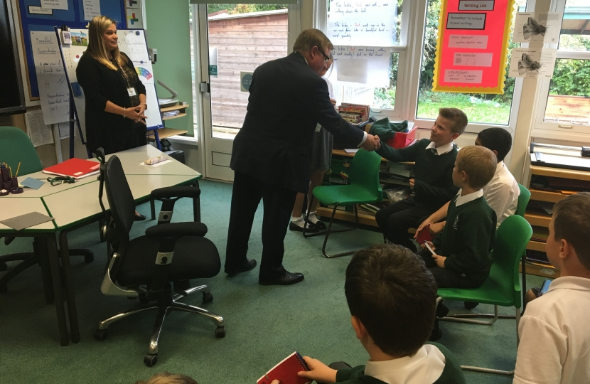 Rayleigh and Wickford MP Mark Francois handing out badges to newly elected School Councillors during his recent visit to Glebe Primary School in Rayleigh.