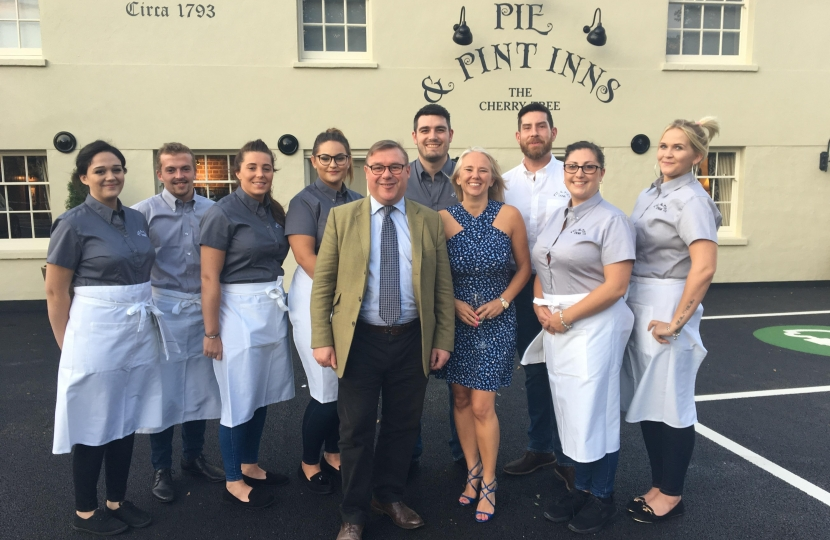 Rayleigh and Wickford MP Mark Francois pictured with co-owner Lisa Honeyman and her staff at the reopening of The Cherry Tree Pub on the Stambridge Road.