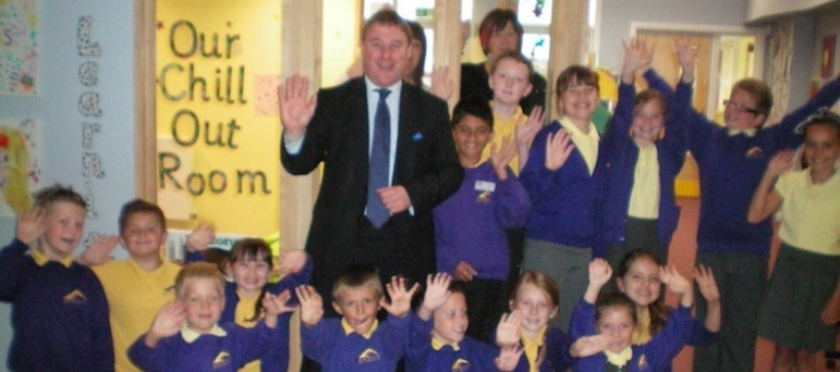 Mark Francois with Headteacher Miss Danniells, staff and pupils outside the special chill out room, which he saw during a recent visit to Abacus Primary School in his constituency